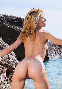 Ariel Nude On The Rocky Beach