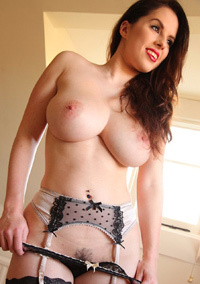 Busty Brunette Strips Off Her Black Stockings
