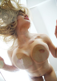 Busty Blonde Candy D Posnig On Glass Table