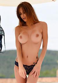 Jennifer Strips Nude By The Pool