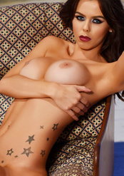 Jennifer Strips Nude On The Sofa